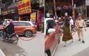 Video: Bị CSGT nhắc nhở, nữ tài xế đỗ ô tô giữa đường chống đối