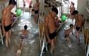 Nam sinh bơm nước ngập kí túc xá... để bơi cho mát