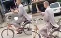 Sư thầy đi xe đạp, thả 2 tay để luyện kungfu