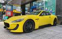 Xe sang thể thao Maserati GranTurismo vàng rực trên phố Sài Gòn