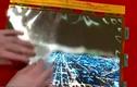 Kinh ngạc chiếc tivi màn hình dẻo có thể cuộn tròn như tờ giấy