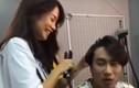 An Nguy tươi cười làm tóc cho Kiều Minh Tuấn trong hậu trường