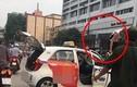 """Bị CSGT """"tuýt còi"""", tài xế taxi leo lên nóc xe ăn vạ"""