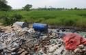 10 thùng phuy nghi chất thải công nghiệp trên Đại lộ Thăng Long