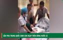 Video: Sản phụ Trung Quốc sinh con ngay trên dòng nước lũ