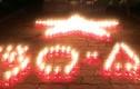 Hơn 15 ngàn ngôi mộ AHLS lung linh ngọn nến tri ân