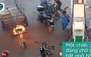 Video: Cháy ở cây xăng, 4 người đàn ông tháo chạy, nữ nhân viên lao vào dập lửa