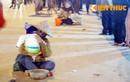 Tập đoàn cái bang lê lết tấn công chợ Viềng