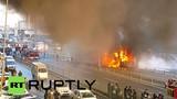 Xe buýt 26 mét cháy rụi giữa phố đông