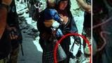 Lạnh người cảnh nữ nghi phạm IS bế trẻ con đi đánh bom liều chết