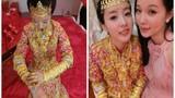 """Câu dâu xinh đẹp mặc """"áo giáp vàng"""" trong ngày cưới"""