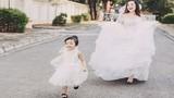 Bà mẹ đơn thân và con gái xinh đẹp trong váy cưới