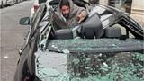 Người đàn ông rơi từ tòa nhà 9 tầng làm nát mui xe BMW
