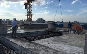 Hà Nội: Hoàn thành phá dỡ tầng 18 của tòa nhà 8B Lê Trực