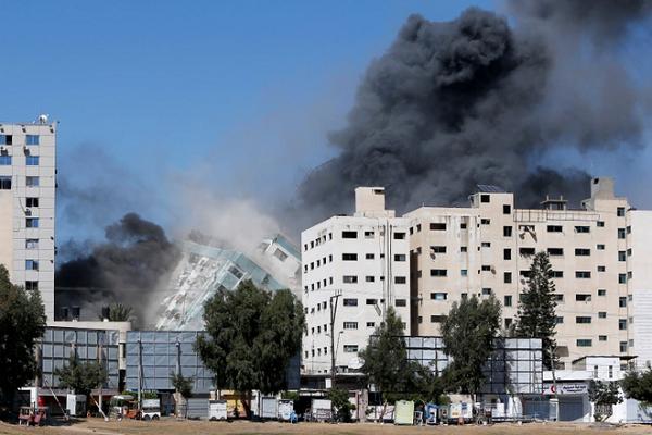 Ten lua Israel danh sap toa nha dat van phong AP, Al Jazeera o Gaza