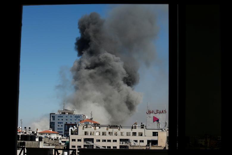 Can canh toa nha dat van phong AP o Gaza bi Israel san phang-Hinh-10