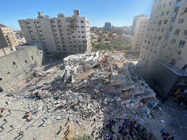 Can canh toa nha dat van phong AP o Gaza bi Israel san phang-Hinh-11