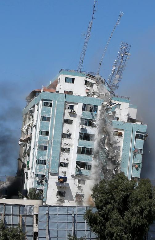 Can canh toa nha dat van phong AP o Gaza bi Israel san phang-Hinh-3