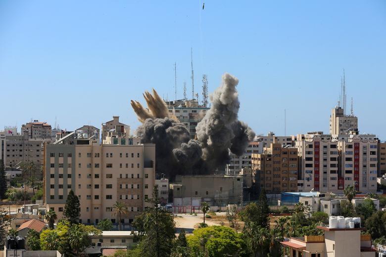 Can canh toa nha dat van phong AP o Gaza bi Israel san phang-Hinh-9