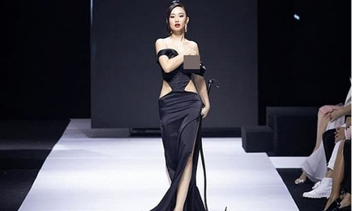 Huong Tra lo nguc dien thoi trang: My nhan mac phan cam tra gia sao?