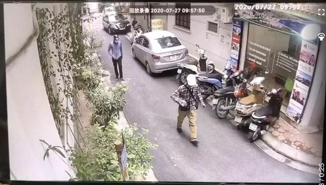 Vu cuop ngan hang BIDV: Dac diem nhan dang cua 2 doi tuong-Hinh-3