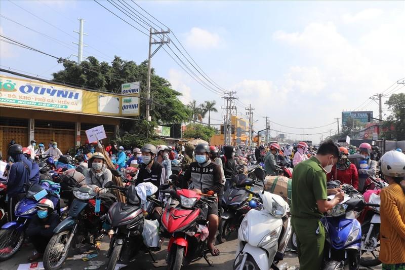 Nguoi ve tu TP HCM, Binh Duong, Dong Nai, Long An phai cach ly the nao?