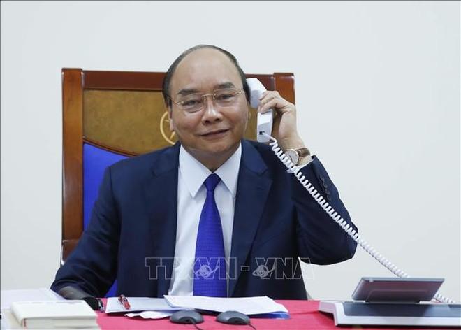 Thu tuong Nguyen Xuan Phuc tin tuong Hoa Ky som kiem soat dich COVID-19