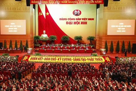 Dai hoi Dang lan thu XIII: Thong qua chuong trinh lam viec, quy che bau cu