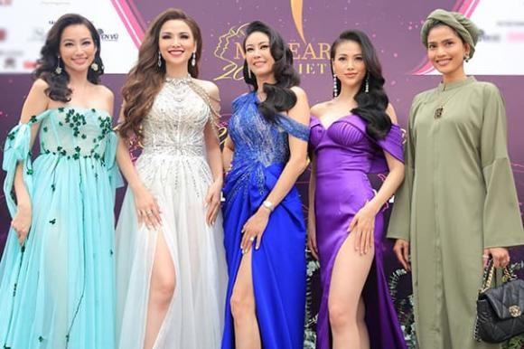 Nam Em can nguoi diu tren tham do hop bao Miss Earth Vietnam