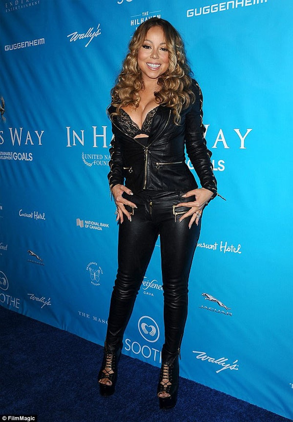 Mariah Carey nem may tinh qua cua so vi tuc hon phu-Hinh-2