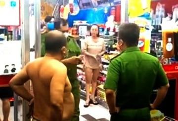 Nguoi phu nu khong deo khau trang, gay roi o TP.HCM