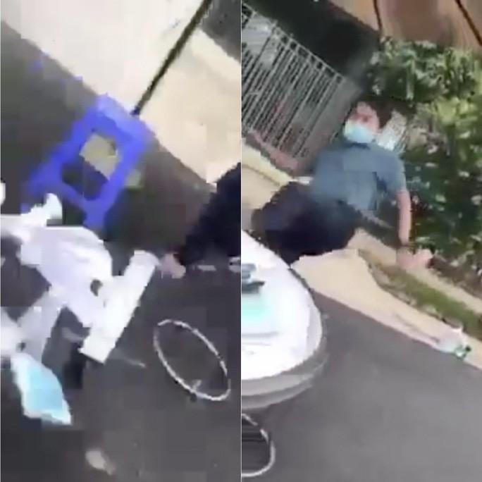 """Video: Lam ro vu nguoi dan ong quat """"Bien!"""" roi dap do ban lam viec cua nhan vien y te"""