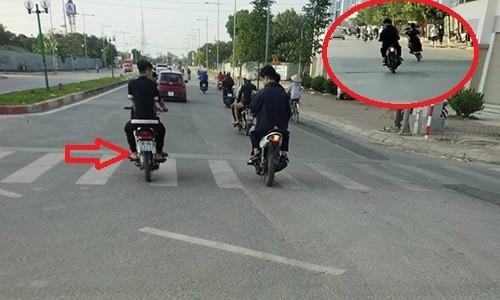 Kinh hai thanh nien khong doi MBH, boc dau xe may nao loan duong