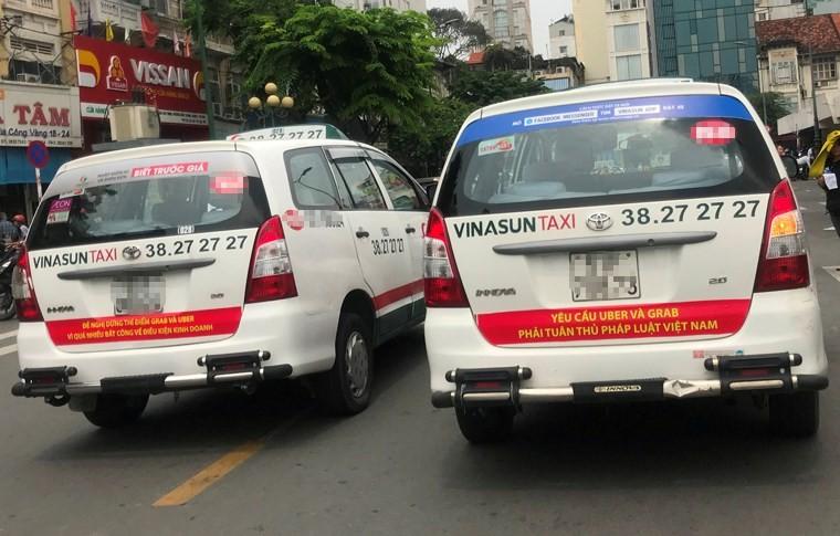 "Lanh dao Vinasun co ""phui"" trach nhiem vu ""noi xau"" Uber, Grab?"