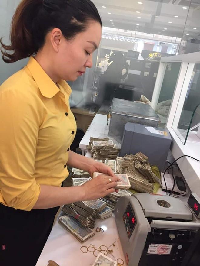 Vo chong cu ong o Quang Binh cho bao tai tien le gui tiet kiem-Hinh-2