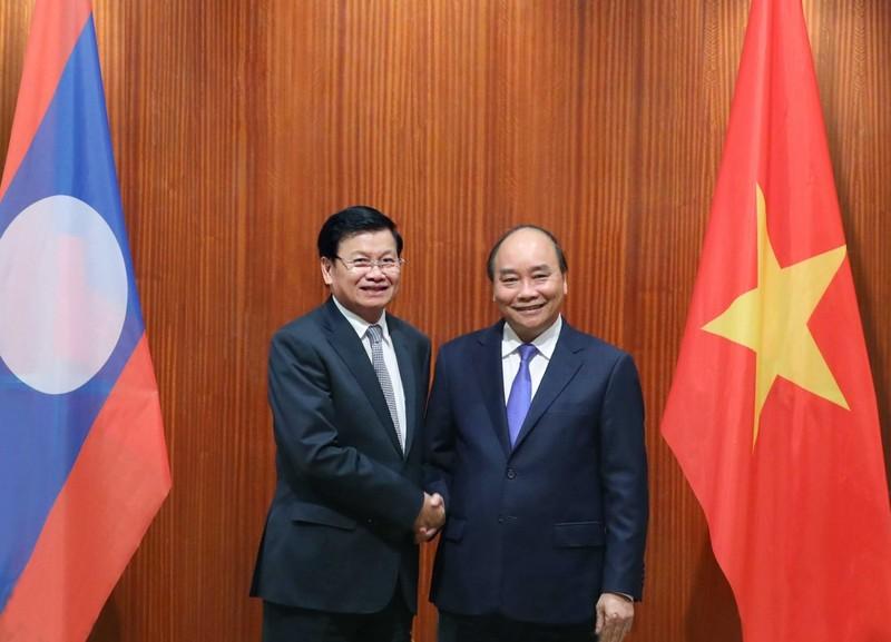 Chu tich nuoc va phu nhan len duong tham chinh thuc CHDCND Lao