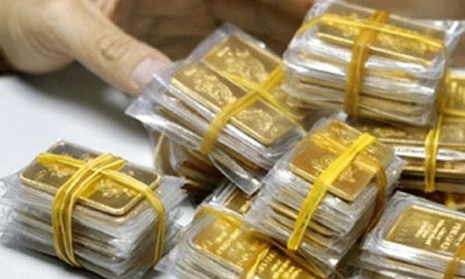 Gia vang hom nay 18/12: Tang khong ngung, tien sat nguong 1.900 USD/ounce