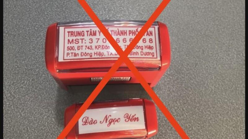 Cong an Binh Duong bat giu 3 doi tuong lam gia giay test COVID-19-Hinh-2