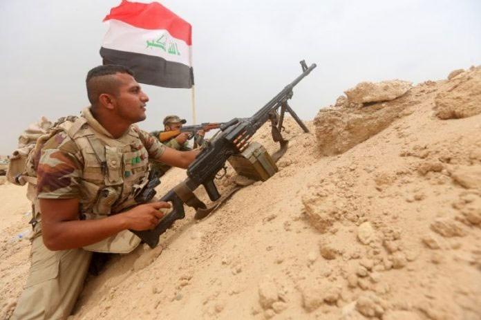 Quan doi Iraq gan gianh duoc toa nha o tay Mosul