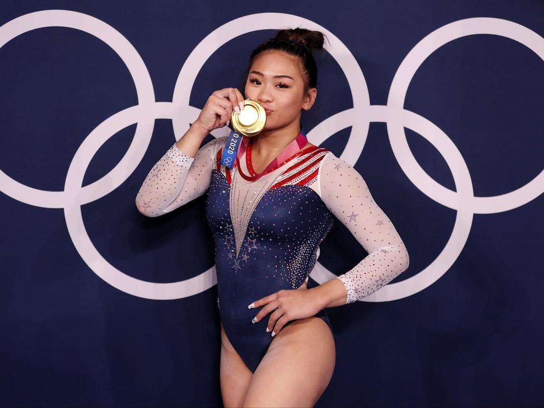 Co gai goc H'Mong o Olympic Tokyo chuong mac ao ho eo