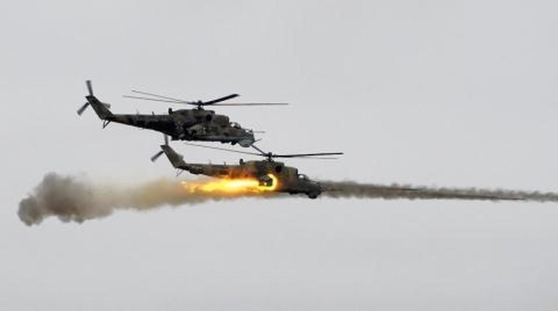 Soi truc thang Mi-24 Ai Cap mang rocket S-80 pho dien suc manh o Libya-Hinh-4