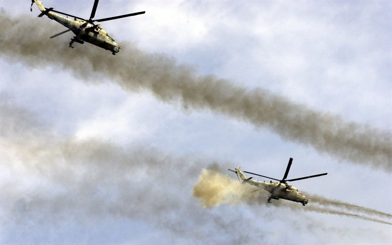 Soi truc thang Mi-24 Ai Cap mang rocket S-80 pho dien suc manh o Libya-Hinh-8