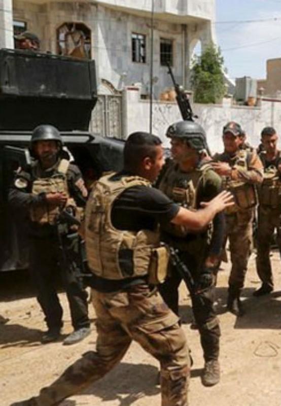Canh nguoi dan Iraq tro ve thanh pho Heet vua giai phong-Hinh-7