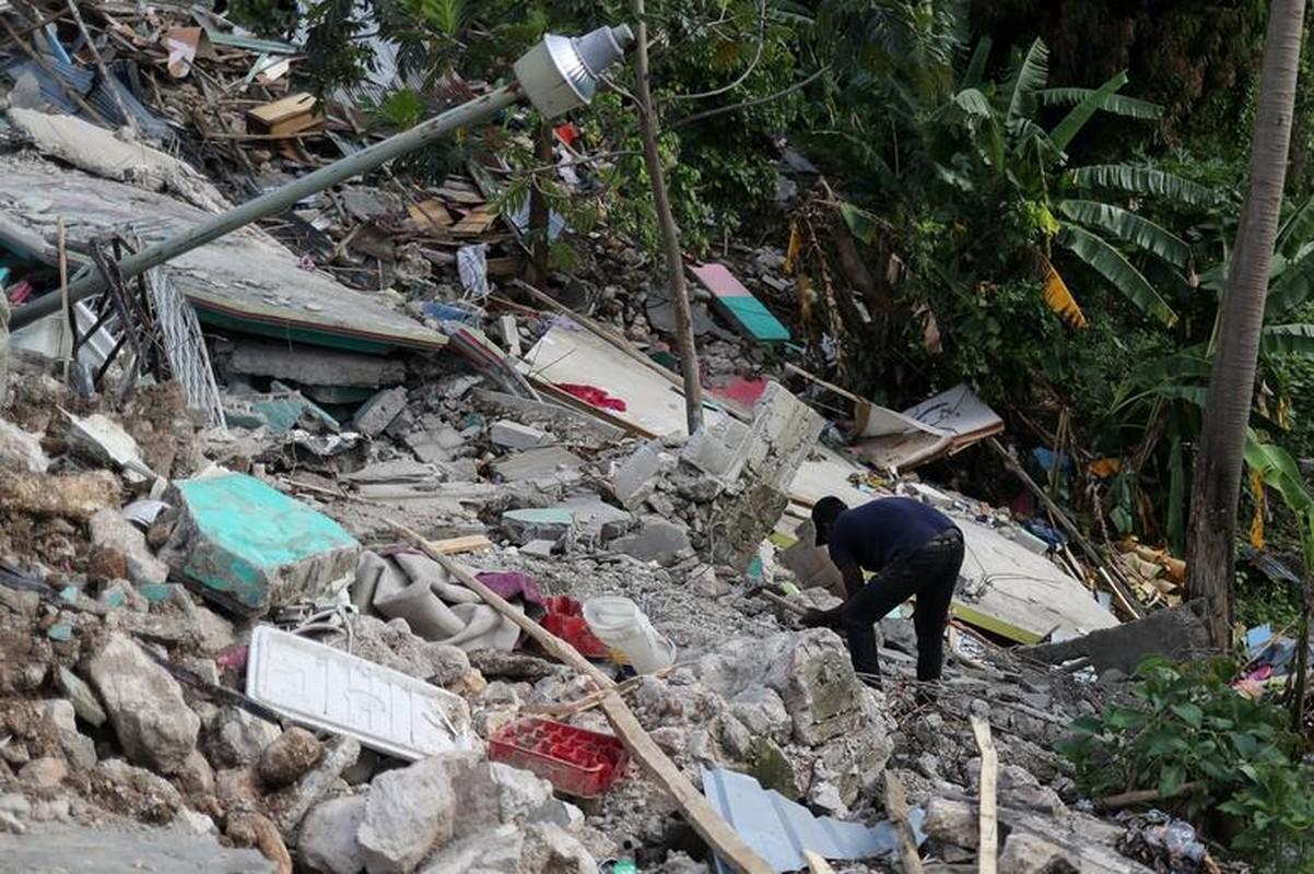 Cuoc song o Haiti sau tham hoa dong dat hon 2.200 nguoi chet-Hinh-11
