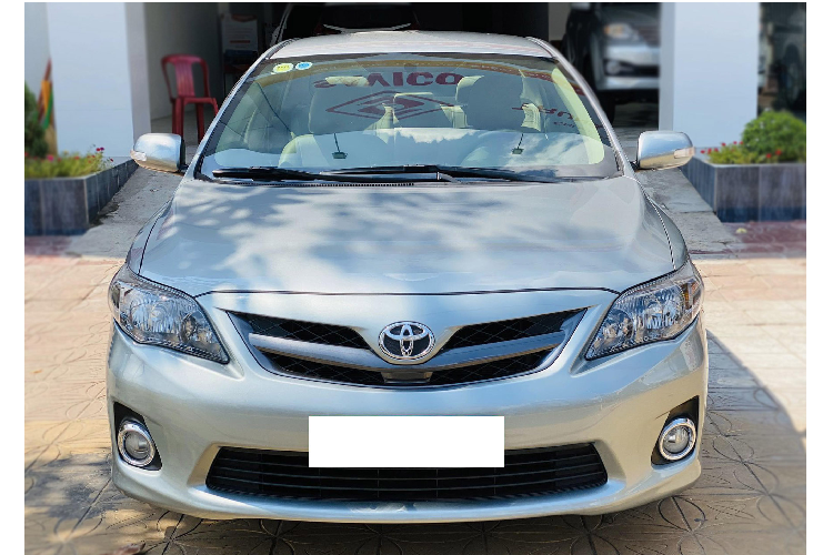 Chay gan 10 nam, Toyota Corolla Altis thet gia hon 500 trieu dong-Hinh-2