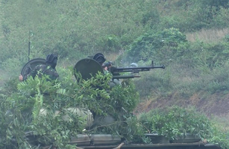 Sung may phong khong 12.7mm tren xe tang chu luc va buoc di lich su-Hinh-2