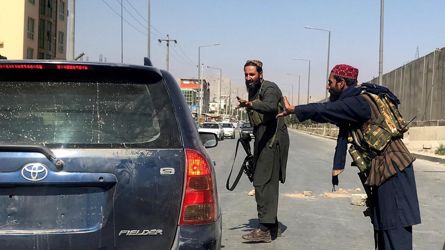 Afghanistan: Sung ong va bao luc tran lan khi Taliban nam quyen-Hinh-8