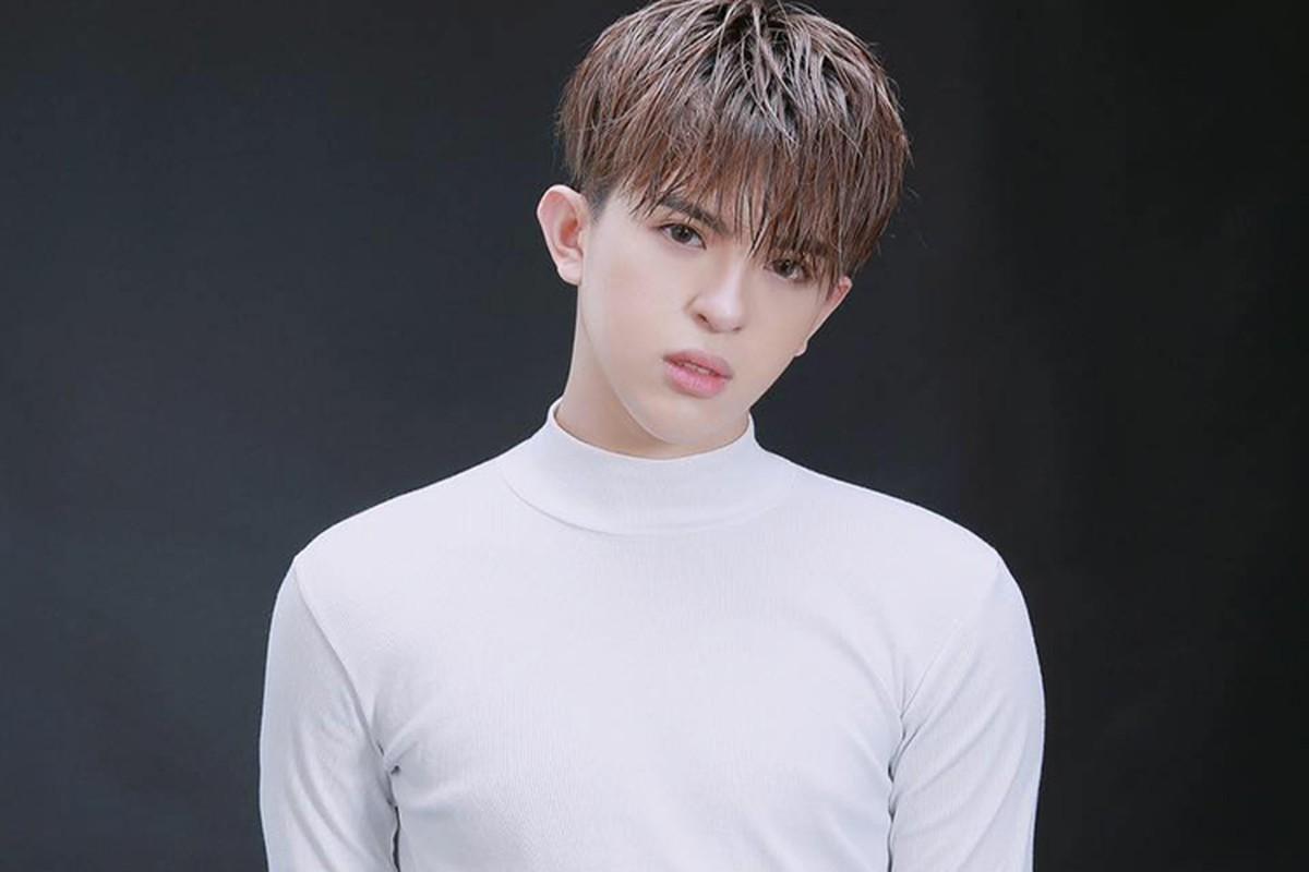 Chan dung con trai dong tinh dien trai cua HH Thu Hoai