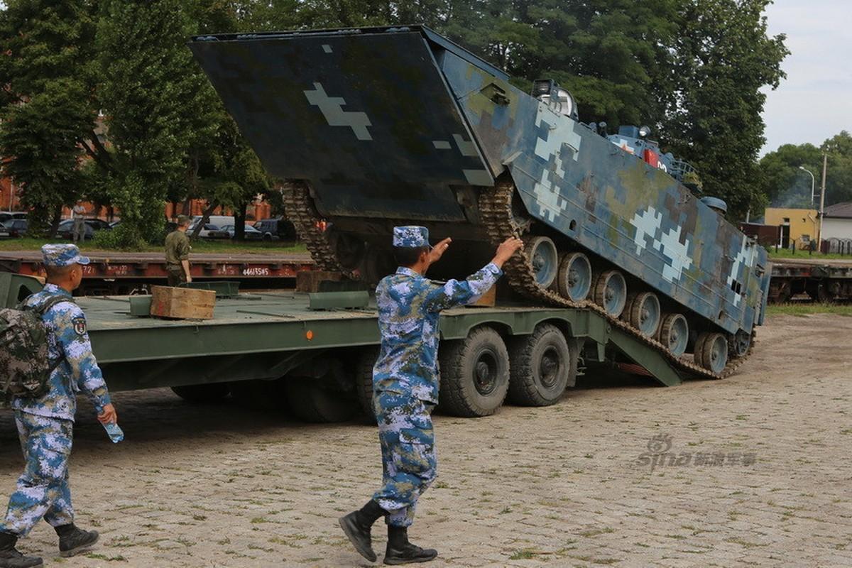 Anh: Xe boc thep Trung Quoc lu luot rut khoi Nga-Hinh-8