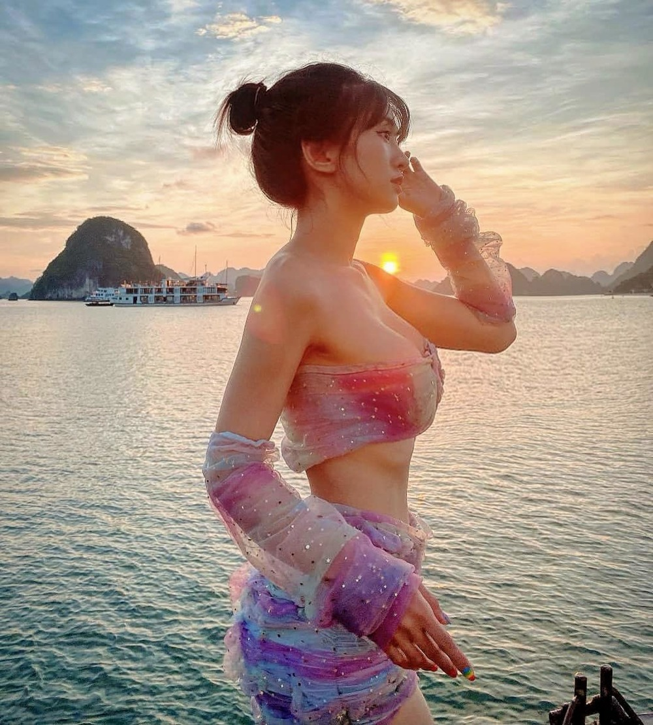 Mua cua song tha ve bien, hot girl Le Bong gay tranh cai-Hinh-8